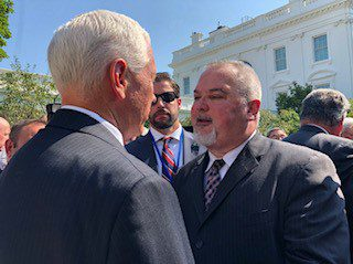 Vice President Mike Pence with Phil Alvarez on the White House lawn